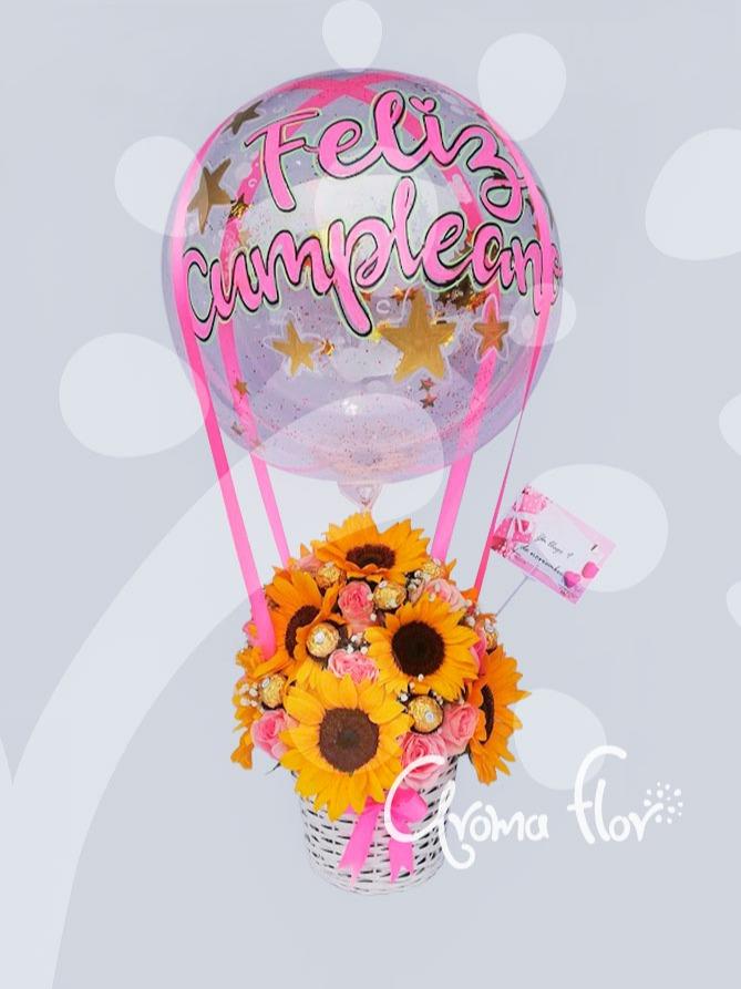 Canasta de girasoles rosas chocolates y globo